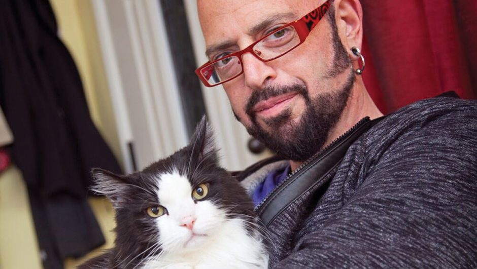 Jackson Galaxy with black and white cat