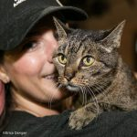 woman and tabby cat