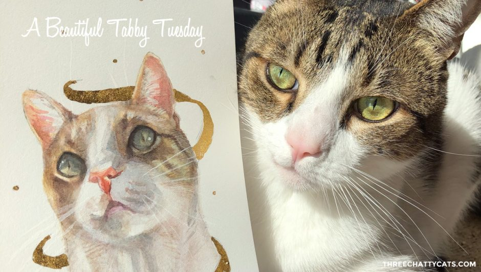 tabby cat with his portrait